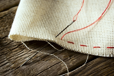 jute texture: Needle and natural linen canvas texture for the background on wooden table