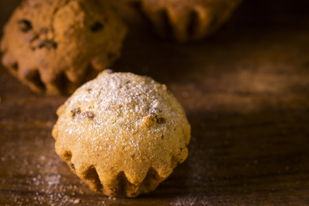 baked goods: Breakfast: muffins on wooden table