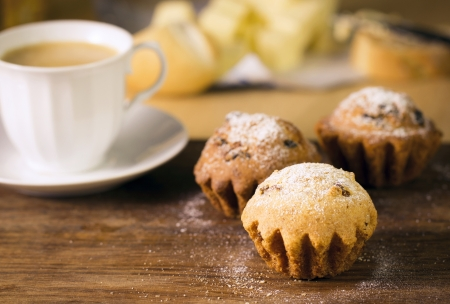 Breakfast: muffins and coffee on wooden table photo