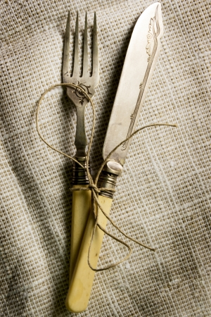 Vintage silverware on burlap background