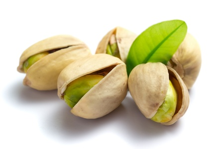 Pistachio nuts with leaf isolated on white