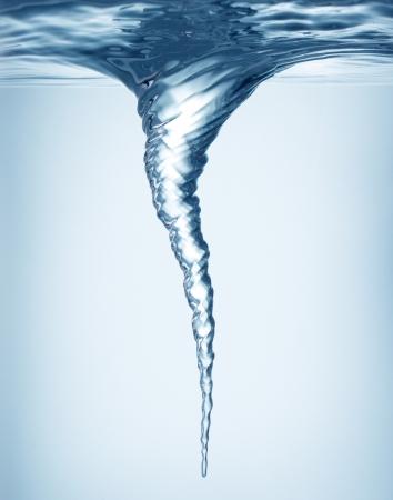 Whirlpool underwater in blue photo