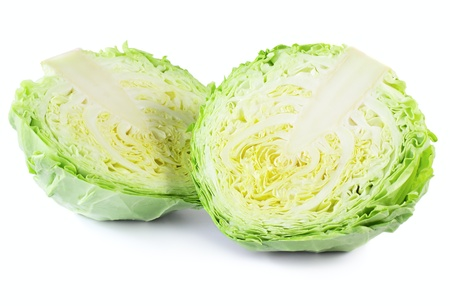 Two halfs of cabbage isolated on white