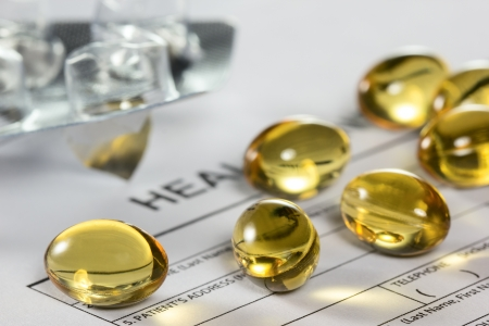 doctor fish: Cod liver oil capsules on health insurance form