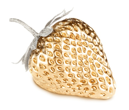 Gold strawberry with silver leaves isolated on white