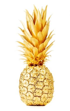 Pineapple in gold isolated on white Reklamní fotografie