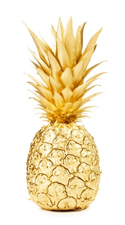 Gold pineapple isolated on white background photo