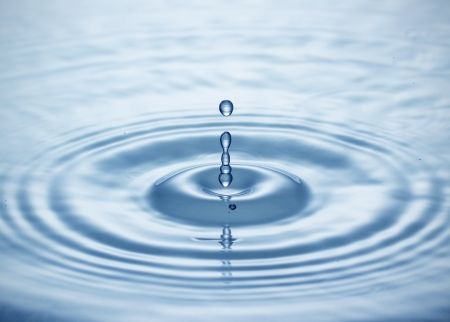 Blue water drop falling down