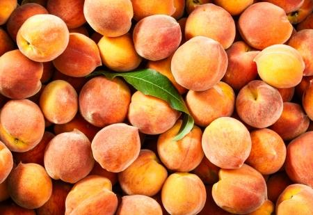 Fresh ripe peaches background Reklamní fotografie