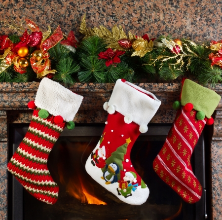 traditional gifts: Christmas stocking on fireplace background