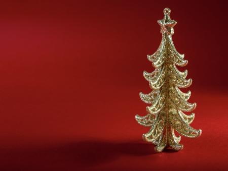 Christmas tree on dark red background photo