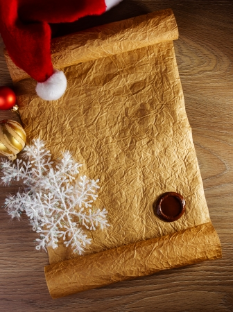 Letter for Santa with christmas hat on wood background photo