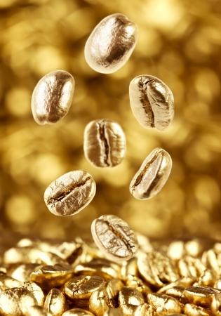 golden bean: Gold coffee beans falling down