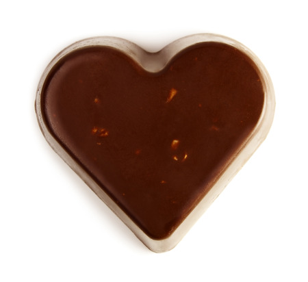 Chocolate valentine heart isolated on white background photo