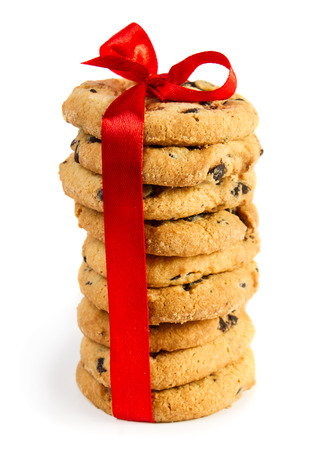 Cookies with red ribbon isolated on white  photo