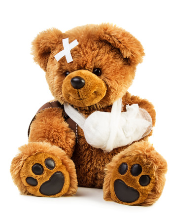 Teddy bear with bandage isolated on white background Stock Photo