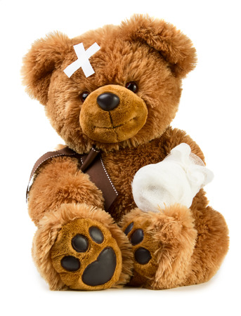 injure: Teddy bear with bandage isolated on white background Stock Photo