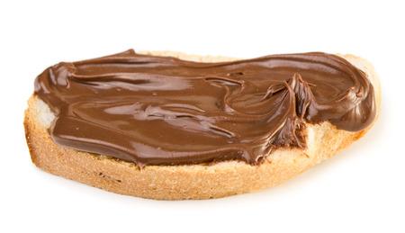 Pan con la extensi�n del chocolate aislado en el fondo blanco Foto de archivo