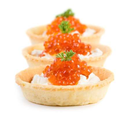Three caviar snacks isolated on white background photo