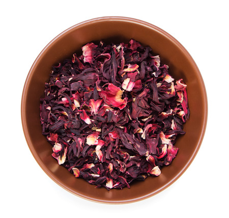 Dry hibiscus tea isolated on white background