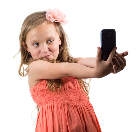 self expression: Little girl doing photo of her self over white background