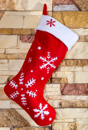 Christmas stocking on brick wall background photo