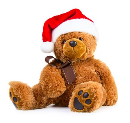 oso blanco: Oso de peluche que llevaba un sombrero de Papá Noel aislado en el fondo blanco Foto de archivo