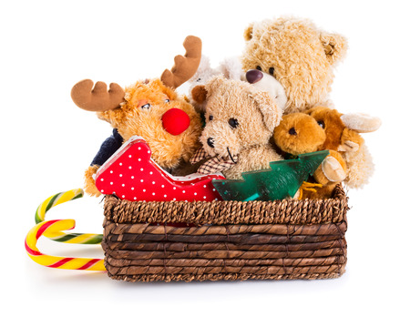 Stuffed animal toys in a christmas sledge isolated on a white background Standard-Bild