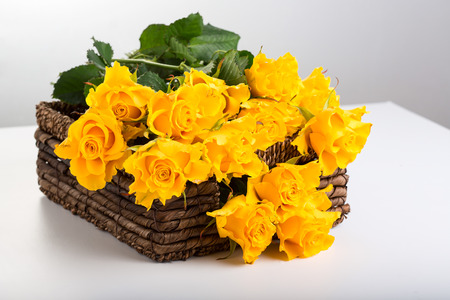 valentinas: Beautiful bouquet of roses in basket on white background