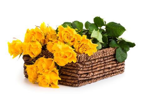 Beautiful bouquet of roses in basket isolated on white background