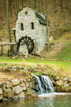 grist mill: Stone watermill springtime in the Carpathians Stock Photo