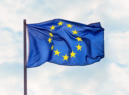 Flag of European Union over blue sky background Stock Photo