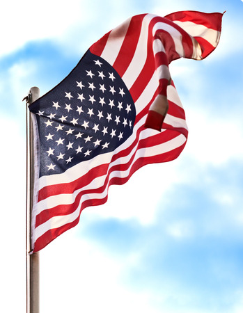 Flag USA over blue sry background Stock Photo