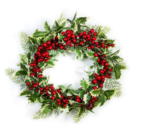 ilex aquifolium holly: Christmas wreath of holly berries and leaves isolated on white background Stock Photo