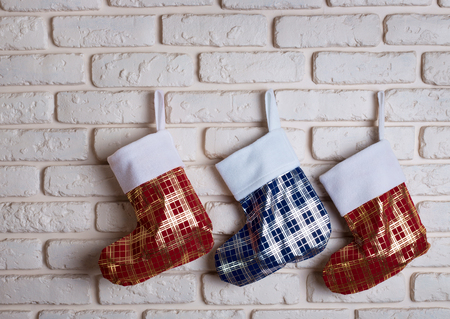 stocking: Three Cristmas stock over brick wall background