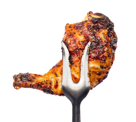 quater: Barbecued chicken leg on a fork isolated on white background Stock Photo
