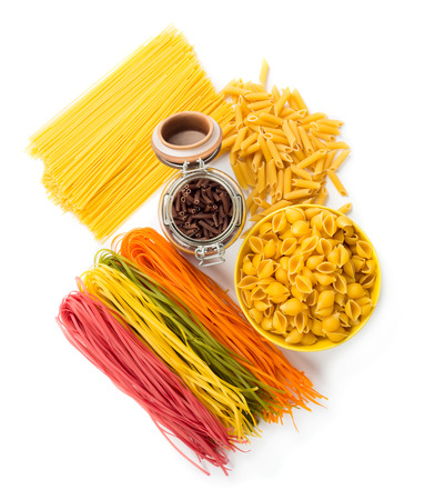 Assortment of raw multicolored pasta isolated on white background. Top view
