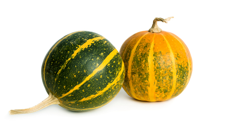 Green and orange small pumpkins isolated on white background