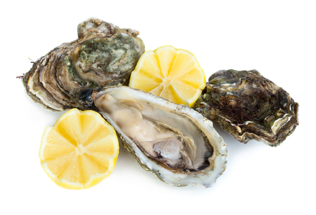 Fresh raw oysters with lemon slices isolated on white background