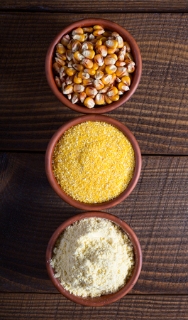 Corn seed, groats and flour, raw food concept Stock Photo