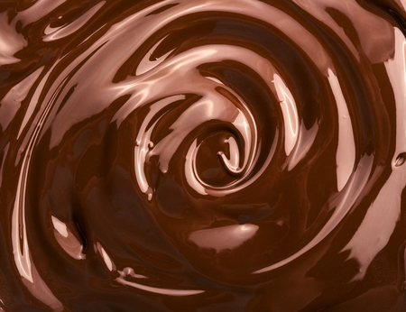 Melted chocolate swirl background Фото со стока