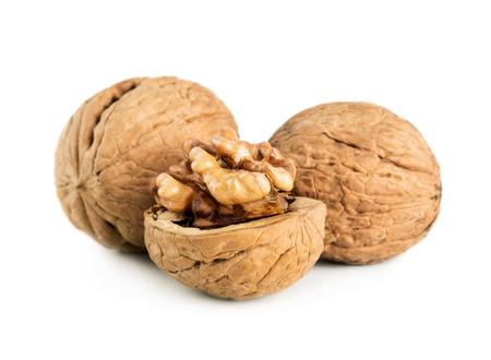 Cracked walnut isolated on white background