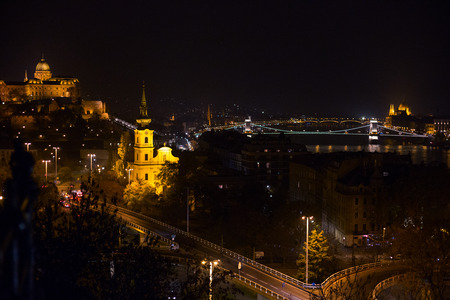 Night view of Budapest. Panorama cityscape of famous tourist destination with Danube, parliament and bridges. Travel illuminated landscape in Hungary, Europe.