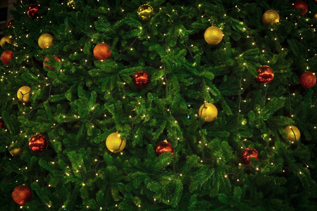 Christmas background with light, red and gold balls