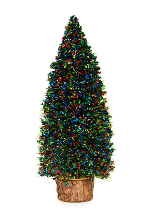Small toy artificial fir tree isolated on white background