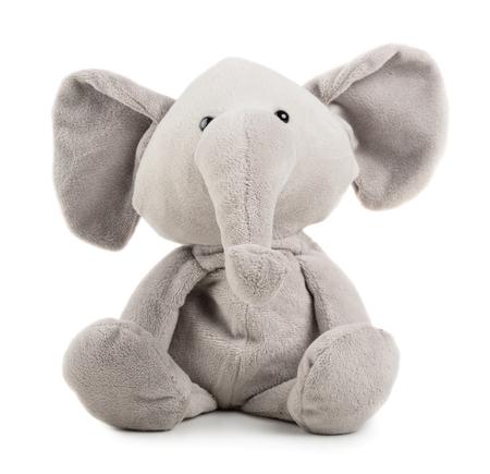 Grey adorable toy elephant isolated on white background