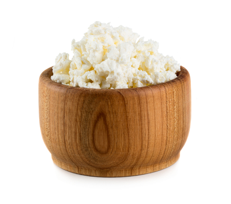 Cottage cheese in wooden bowl isolated on white background