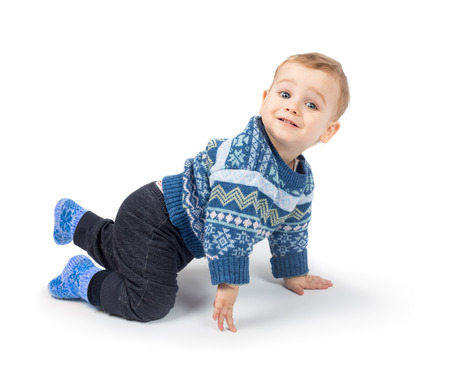 Cute little boy crawls isolated on white background