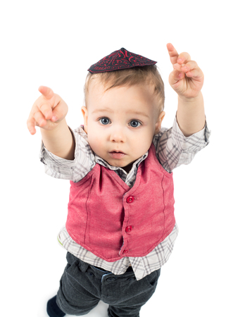 Cute little boy with yarmulk isolated on white background