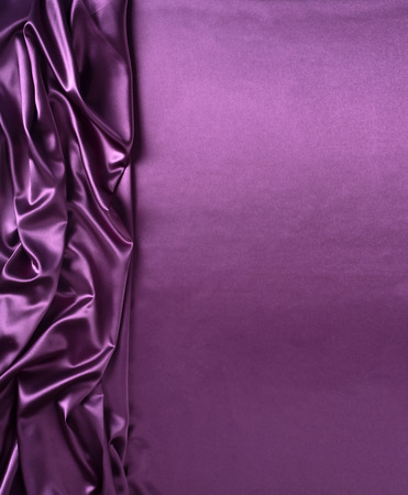 Smooth elegant purple silk or satin texture can use as abstract background. Luxurious background design